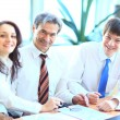 Happy group of business smiling at the office - Stock Photo