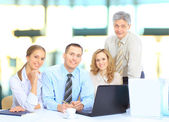 Group of businessmen discussing income. — Stock Photo