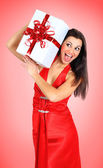 Beautiful girl with gifts. — Stock Photo
