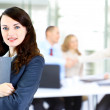 Confident business woman with team behind her — Stock Photo #22660789