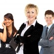 Confident business woman with team behind her — Stock Photo #22661071