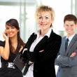 Confident business woman with team behind her — Stock Photo