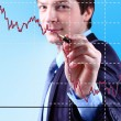 Stock Photo: Business Man write graph on transparent digital screen