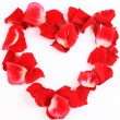Royalty-Free Stock Photo: beautiful heart of red rose petals isolated on white