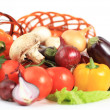 Composition with raw vegetables and wicker basket isolated on wh — Stock Photo