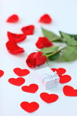 A rose and a box — Stock Photo
