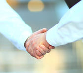 Beautiful business women reaches out a hand for a handshake. Isolated on a white background. — Stock Photo