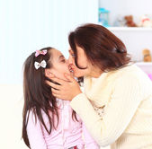 The mother with her daughter at home. — Stock Photo