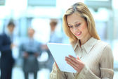 Handsome businesswoman using his digital tablet — Stock Photo