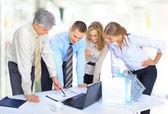 Group of businessmen the conclusion of the transaction. — Stock Photo