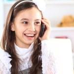 Little girl talking on the phone. — Stock Photo