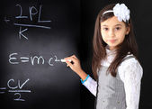 The little girl decides to mathematical equations. — Stock Photo