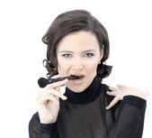 Beautiful woman with makeup brush near her face - isolated on wh — Stock Photo
