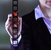 Business woman hand choose check mark on box — Stock Photo