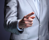The businessman, a gesture, a finger. — Stock Photo