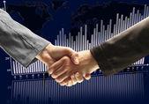 Handshake - Hand holding on dark background — Stock Photo
