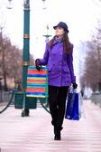 Beautiful girl walking down the street. — Stock Photo