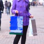Beautiful girl walking down the street. — Stock Photo #28289221