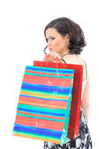 Happy young adult girl, with color-coded bags. — Stock Photo