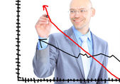 Businessman draws a graph. Isolated on a white background. — Stock Photo