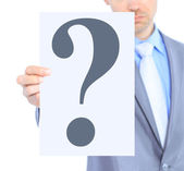 Nice businessman, with a question mark. Isolated on a white background. — Stock Photo