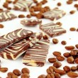 Sweet chocolate candies and coffee beans isolated on white background   — Stock Photo