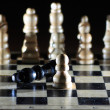 Composition with chessmen on glossy chessboard — Stock Photo