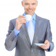 Businessman, drinking coffee. Isolated on a white background. — Stock Photo #31852999