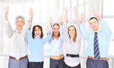 Image of business people giving the thumbs-up sign — Stock Photo