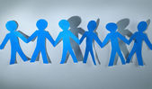 Teamwork, paper people over white background — Stock Photo