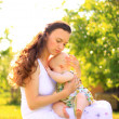 Beautiful Mother And Baby outdoors. — Stock Photo