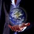 Business hand holding globe(Collage images from www.nasa.gov) — Stock Photo