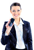 Beautiful business woman points to the phone. Isolated on a white background. — Stock Photo