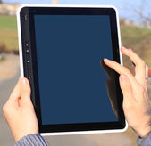 Female hands holding a tablet touch computer gadget with isolated screen — Stock Photo