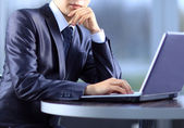 Person Typing on a modern laptop in an office — Stock Photo