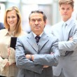 Happy smiling business team standing in a row at office — Stock Photo #36025185