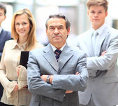 Happy smiling business team standing in a row at office — Stock Photo
