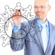 Businessman drawing the world map in a whiteboard — Stock Photo #36359045