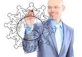 Businessman drawing the world map in a whiteboard — ストック写真