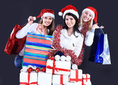 Girls with a new year gift on a dark background — Stock Photo