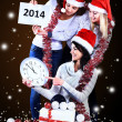Girls with a new year gift on a dark background — Foto Stock