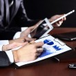 Close-up picture of businessman's hand writing in the document — Stock Photo