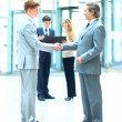 Stock Photo: Business people shaking hands, finishing up meeting