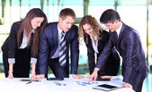 Business team working on their business project together at office — Stock Photo