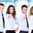 Foto Stock: Group of four business people in row pointing