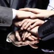 图库照片: Team work concept. Business people joining hands
