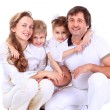 Beautiful happy family - isolated over a white — Stock Photo #40299663
