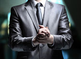 Hands steady business man on a dark background — Stock Photo