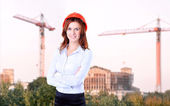 Successful business woman looking confident and smiling — Stock Photo