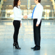 Cheerful businesspeople, or businesswoman and client handshaking — Foto de Stock